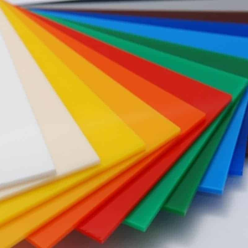 Mulit coloured Acrylic swatches laid out in a fan on a white table