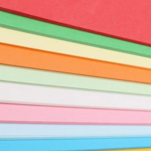 stacks of different coloured papers layered on top of each other